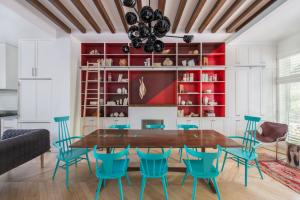 Dining Setting with Blue Chairs, Timber Table & Red Cabinet